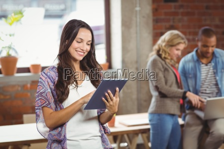 young businesswoman using digital tablet in