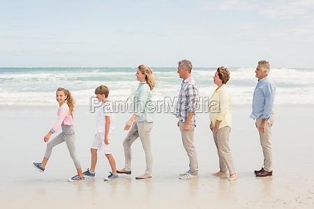 multi generation family standing beside one