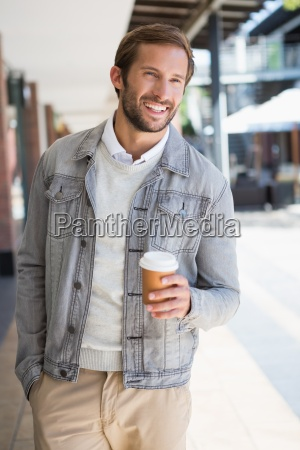 young happy smiling man holding a