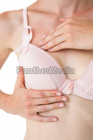 woman with pink ribbon on her