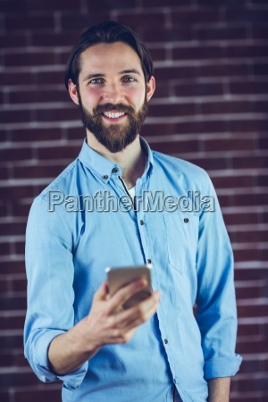 portrait of happy hipster using smartphone