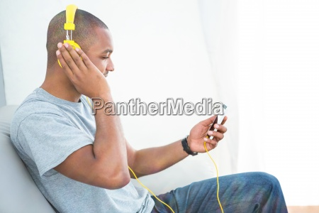 young man listening music on smartphone