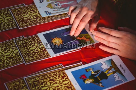 fortune teller using tarot cards