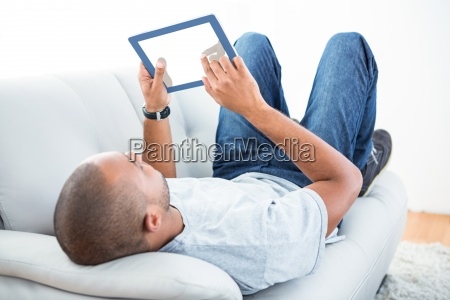 young man using tablet computer on