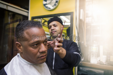 barber giving his client a haircut