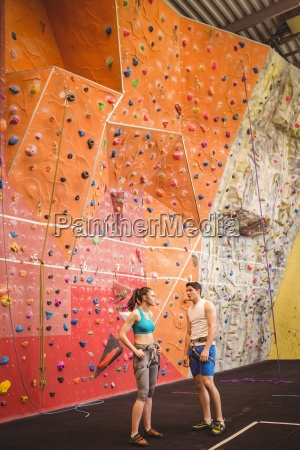 fit couple at the rock climbing