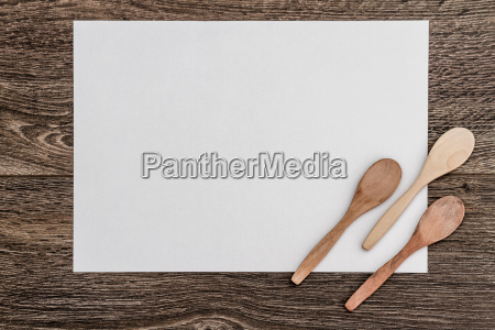 wooden spoons on white paper and