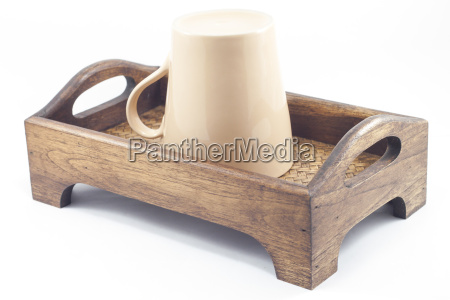 brown mug on wooden tray isolated