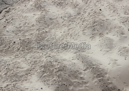 sand dune with unstructured footprints in