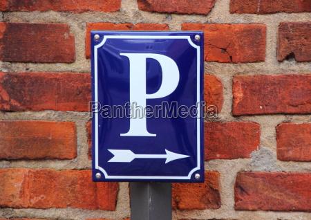 enamel parking lot sign with arrow