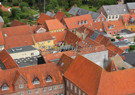 city with red tile roof in