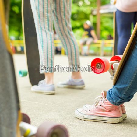 teenage girl practicing riding long board