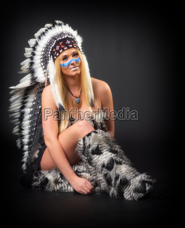 young blonde woman with feather headdress