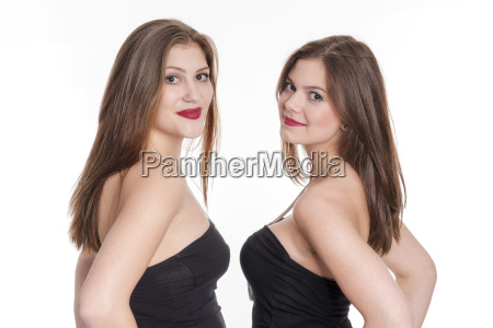 2 brunette women in strapless top