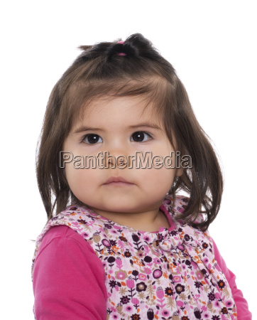 toddler with almond eyes in portrait