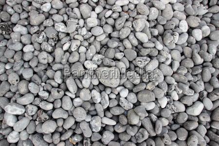 grey rubble beach stones in birdseye