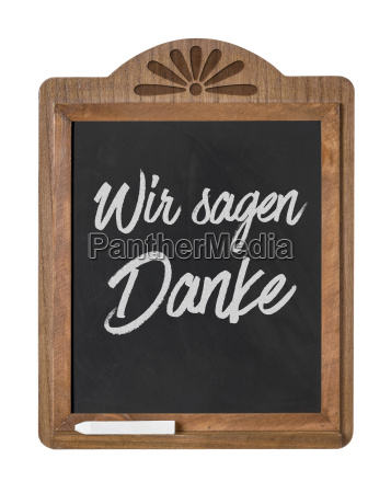 chalkboard with the inscription we say