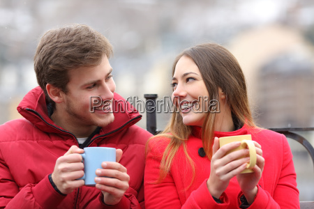 couple talking relaxed in winter