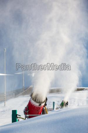 snow machine bursting artificial snow over