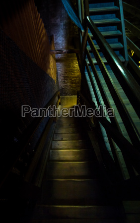 an old hazardous wooden staircase leads