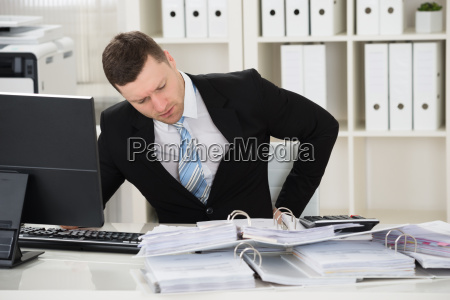 businessman suffering from back pain at
