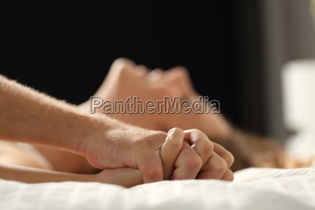 couple having sex on a bed