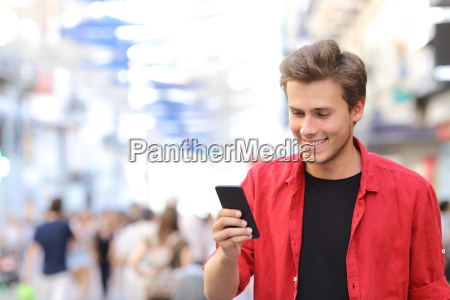 man in red texting on a
