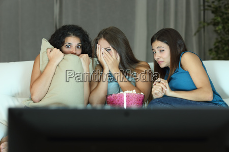 girls watching a terror movie on