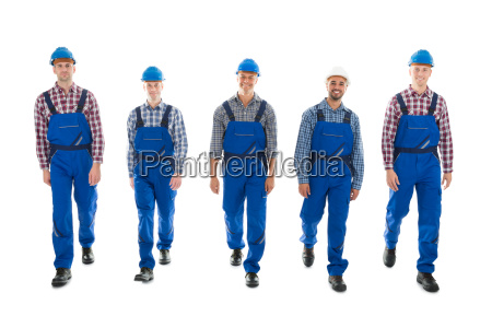 portrait of confident male carpenters walking