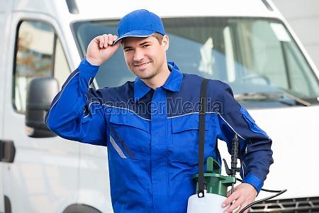confident pest control worker wearing cap