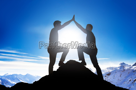 male friends giving high five on
