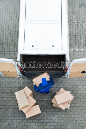 delivery, man, unloading, cardboard, boxes, from - 15775740