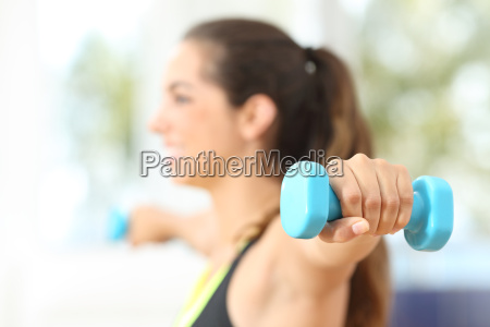 fitness woman doing weights at home
