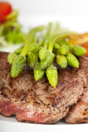wild asparagus on steak