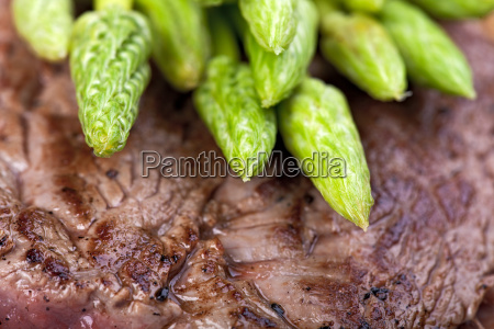 wild asparagus on steak