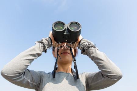 young woman use of the binoculars