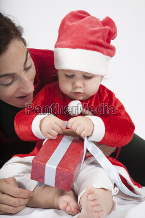 baby santa claus with mother opening