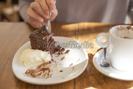 taking chocolate cake