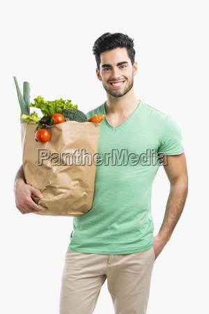 man carrying a bag full of