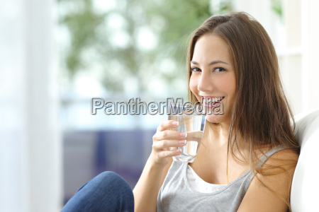 girl, drinking, water, at, home - 15784910