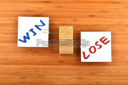 win lose two paper notes in