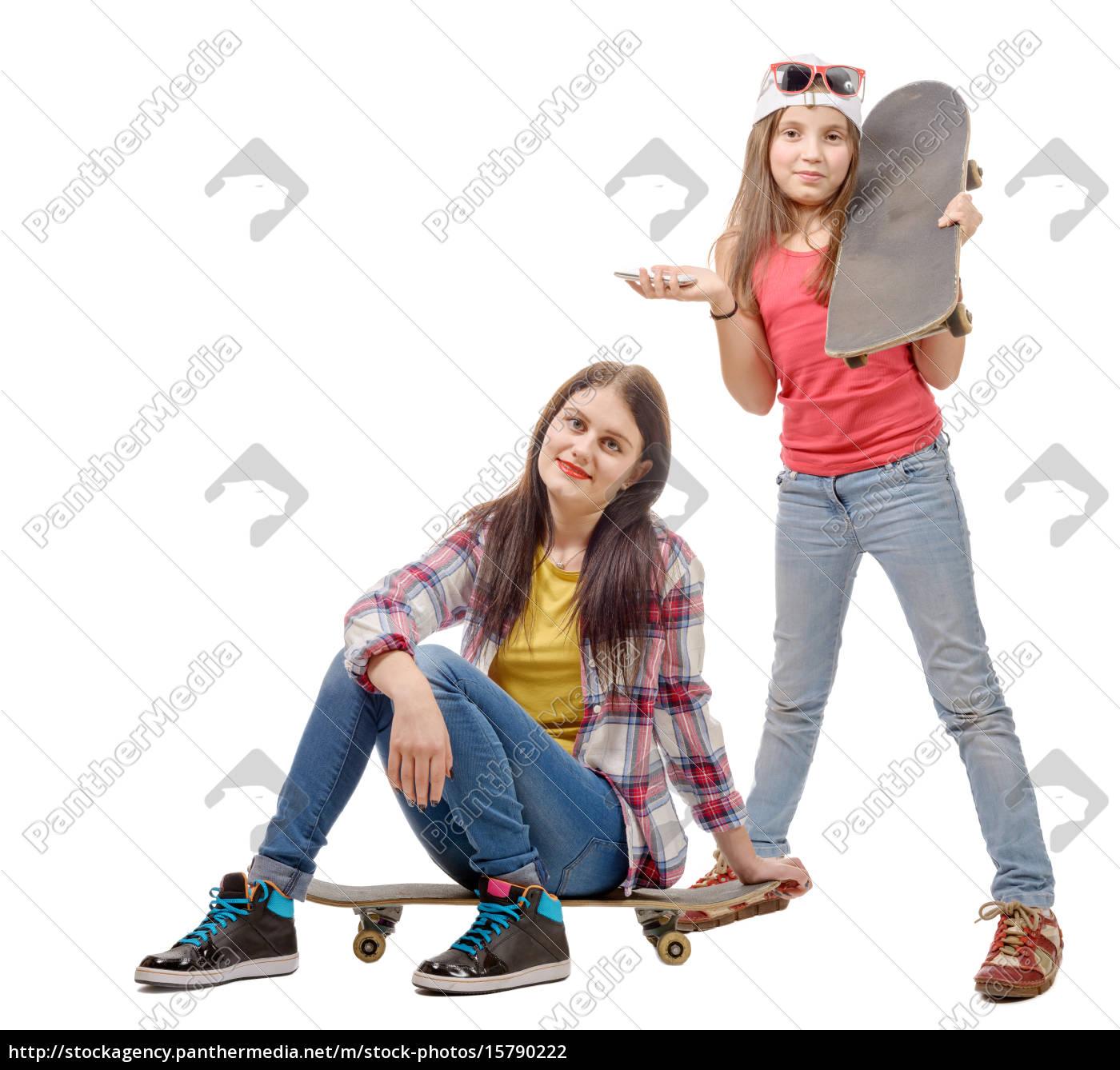 two, fashion, pretty, girls, with, skateboard, - 15790222