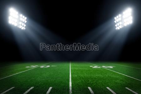 football, field, illuminated, by, stadium, lights - 15794747