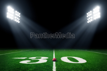 football, field, illuminated, by, stadium, lights - 15794749