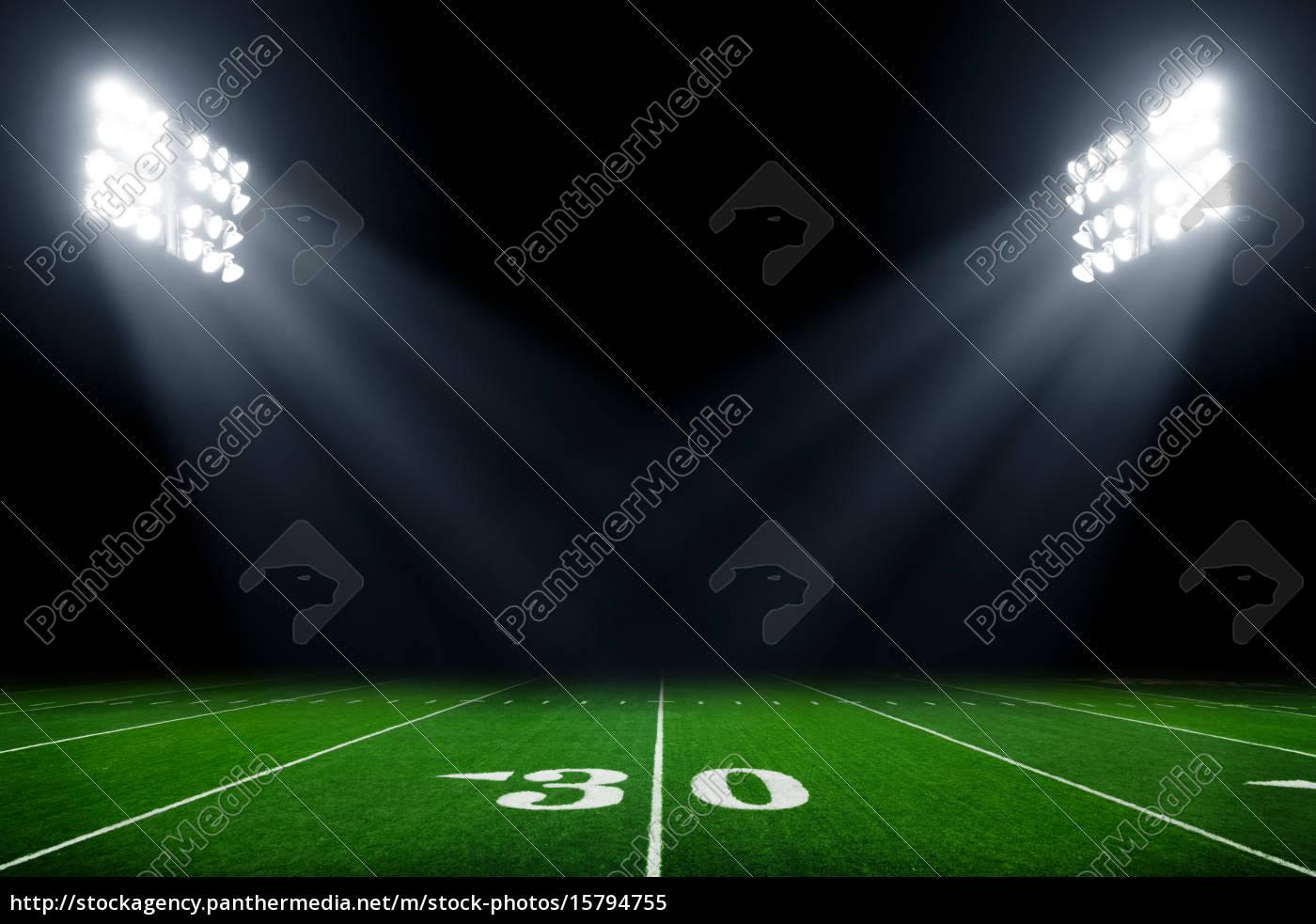 football, field, illuminated, by, stadium, lights - 15794755