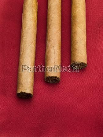 three, cigars, on, red, satin, three, cigars - 15794507