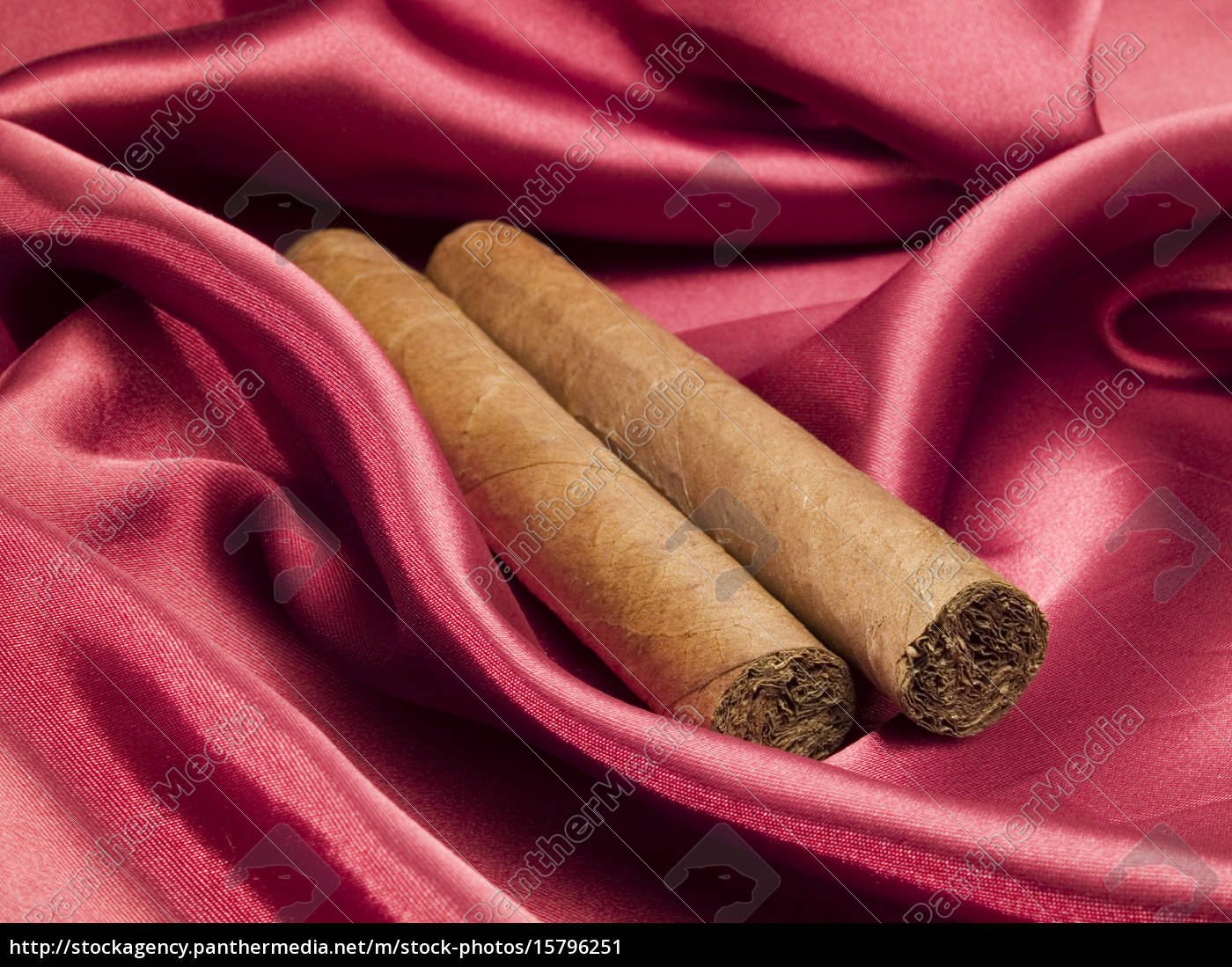 two, cigars, on, red, satin, two, cigars - 15796251