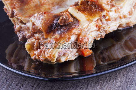 lasagna over black plate