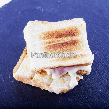 toast over black stone plate