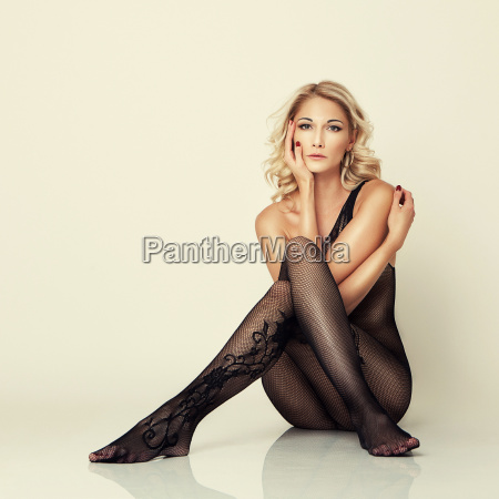 sexy attractive girl in stockings pose